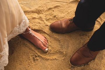 Close up of bridal beach wedding shoes