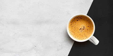 cup of coffee on cement table background