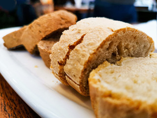 Fototapete - French baguette bread on table
