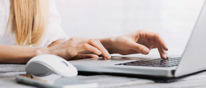 Woman hands typing on computer keyboard closeup, businesswoman or student using laptop panoramic banner, online learning, internet marketing and freelance work concept