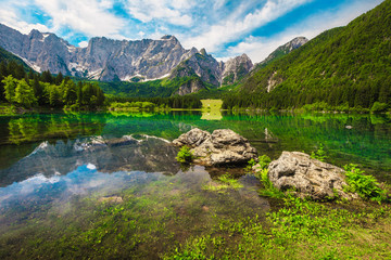 Wall Mural - Lake Fusine with high rocky Mangart mountains in background, Italy