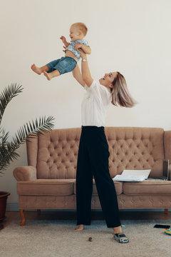 Business mom takes a break. Multi-tasking, freelance and motherhood concept