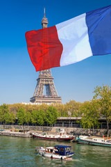 Wall Mural - Paris with Eiffel Tower against french flag during spring time in France