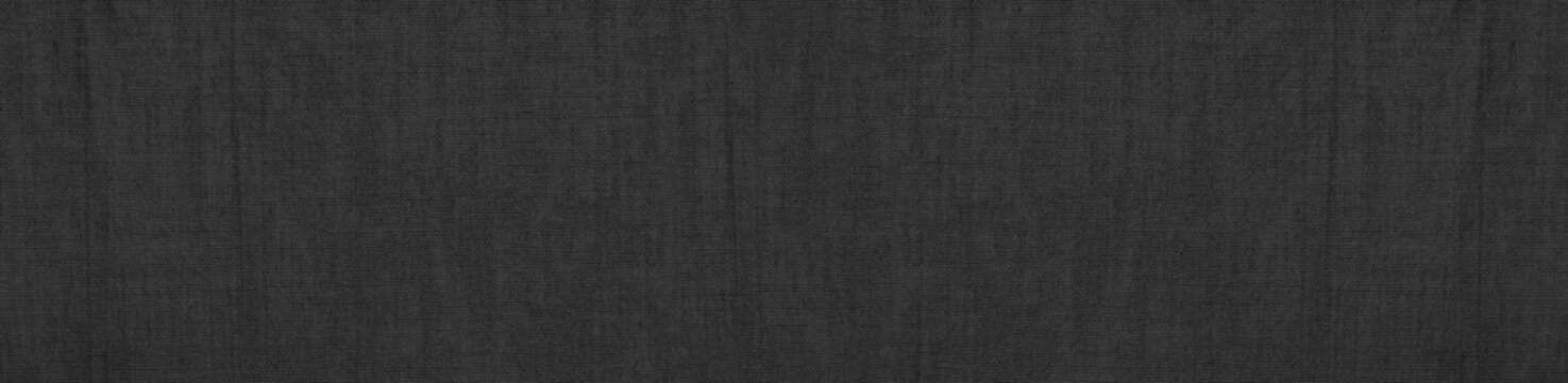 Black abstract background. Texture of natural cotton fabric. Black banner with copy space.