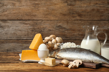 Fresh products rich in vitamin D on wooden table