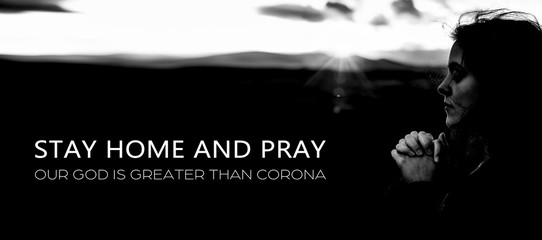 Stay Home and Pray concept. Corona virus. Hard times. Hope and Faith. Our God is greater.