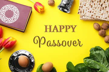 Flat lay composition with symbolic Pesach (Passover Seder) items on yellow background Wall mural