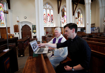 Revd Mark Dearnley looks at screen after Church services were recorded for a live service streaming on YouTube at St Peter's Church as the spread of the coronavirus disease (COVID-19) continues