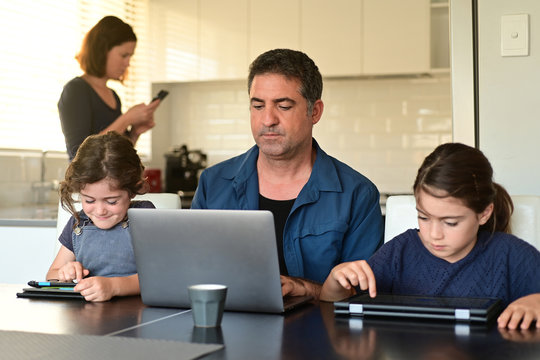 Family at home as the pandemic coronavirus (COVID-19) forces many employees and students to work and study from home