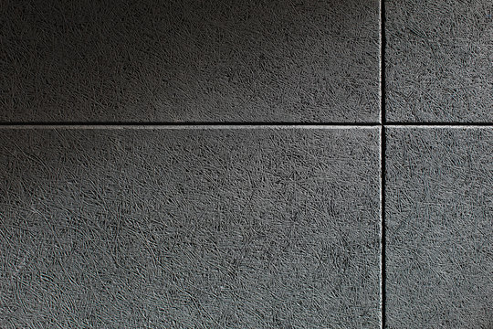 Close up texture of a wall with a grey sound absorbing panel mounted on it. Soundproof wall made of compressed fibers in a sound studio, music salon or club.