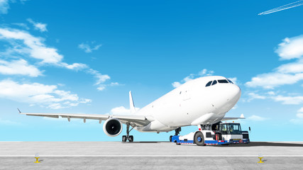 towing cargo airplane to airport runway wide panorama landscape with modern tow tractor on nose gear against clouds blue sky background Aircraft moving by truck Airport overview with cargo plane Wall mural
