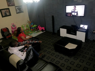 Paul and Chika Oboh watch the YouTube channel of their church on-line, as government struggles to control the spread of the coronavirus disease (COVID-19) in Lagos