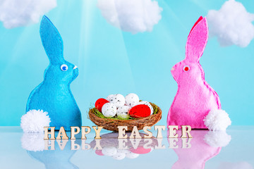 Easter background with eggs and rabbits.