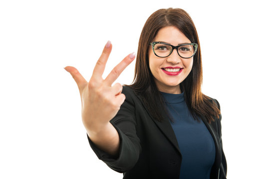 Portrait of young business girl wearing glasses showing number three