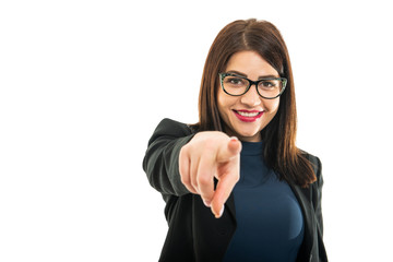 Portrait of young business girl wearing glasses pointing camera
