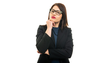 Portrait of young business girl wearing glasses making thinking gesture