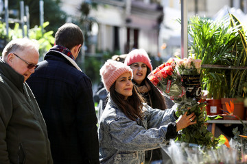 People buy flowers on Columbia Road Flower Market, during the coronavirus disease (COVID-19) outbreak, on Mother's Day in London