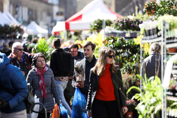 People walk through Columbia Road Flower Market, during the coronavirus disease (COVID-19) outbreak, on Mother's Day in London