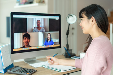 Asian business woman talking to her colleagues about plan in video conference. Multiethnic business...
