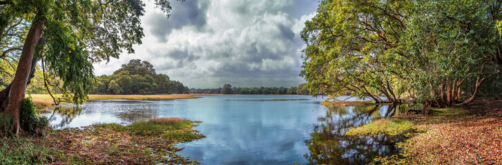 Beautiful panorama of the lake with blue sky and clouds in the Wilpattu national Park.