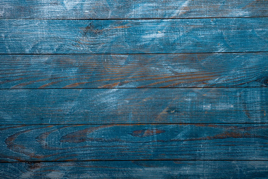 Vintage blue wood background texture with knots and nail holes. Old painted wood wall. Blue abstract background. Vintage wooden dark blue horizontal boards. Front view with copy space. Background for