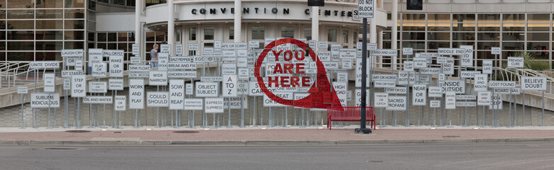 "Artistic display of sings in front of the Salt Lake City Convetion Center which spells out ""You are Here"" when viewed from the correct angle"
