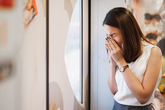 Unhealthy Asian woman sneezing and  cough, ill, sick, from coronavirus(covid-19) , coronavirus covid-19 outbreak concept