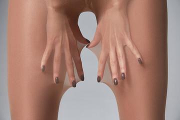 Part of woman body perfect shape hips legs skin tan wear stockings, nylons, pantyhose lingerie...