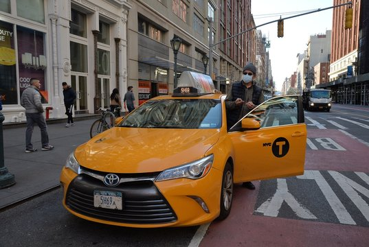 COVID 19, Taxi driver, mask out and about for Coronavirus Disease COVID-19 Pandemic Impacts New Yorkers