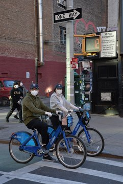COVID 19, bike, masks out and about for Coronavirus Disease COVID-19 Pandemic Impacts New Yorkers