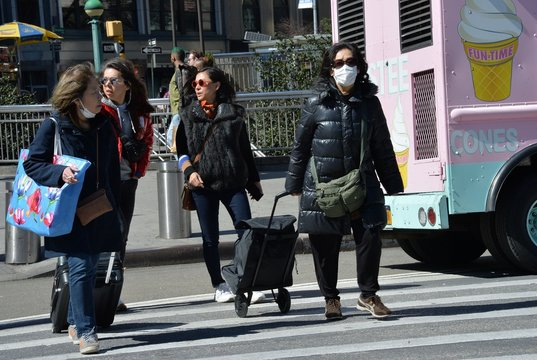 COVID 19, Columbus Circle, masks out and about for Coronavirus Disease COVID-19 Pandemic Impacts New Yorkers