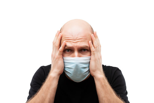 Young adult bald head man wearing respiratory protective medical mask