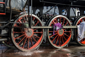 cleaning historical steam locomotive
