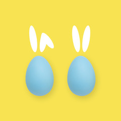 Easter blue and yellow eggs on a colored background with painted rabbit ears.