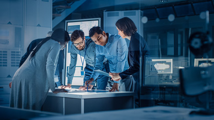 Engineers Meeting in Technology Research Laboratory: Engineers, Scientists and Developers Gathered Around Illuminated Conference Table, Talking and Finding Solution. Industrial Design Facility Fotomurales