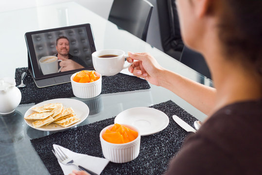 A virtual toast in a video conference  during lockdown in the age of Coronavirus