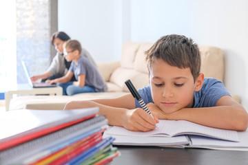 Learning at home, online learning, self quarantine concept. Family at home. Children doing homework...