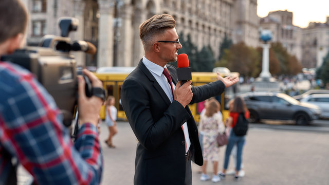 Dedicated, determined, dependable. Professional reporter presenting the news on urban street. Journalism industry, live streaming concept
