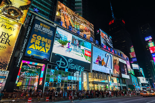 Times Square at night in New York City, USA