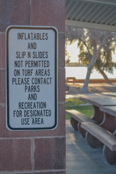 Inflatables and Slip N Slides Not Permitted on Turf Areas in Rotary Community Park. Lake Havasu City, Mohave County, Arizona USA