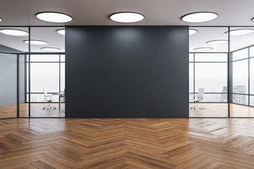 Blank gray wall in coworking office interior.