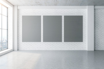 Minimalistic interior with three blank posters on wall Fotomurales
