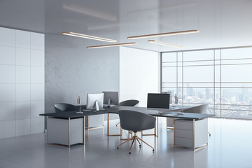 Contemporary coworking office interior with personal computers