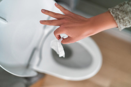 Flushing down disinfectant wipes as toilet paper shortage alternative during panic buying coronavirus outbreark causing home toilets to clog.