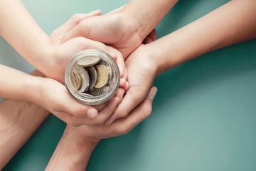 child and parent hands holding money jar, donation, saving, charity, family finance plan concept, Coronavirus economic stimulus rescue package, superannuation concept