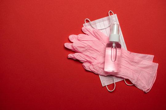 Medical gloves surgical mask, sanitizer gel - Virus protection equipment on red background. China pathogen respiratory coronavirus 2019-ncov flu outbreak medical concept