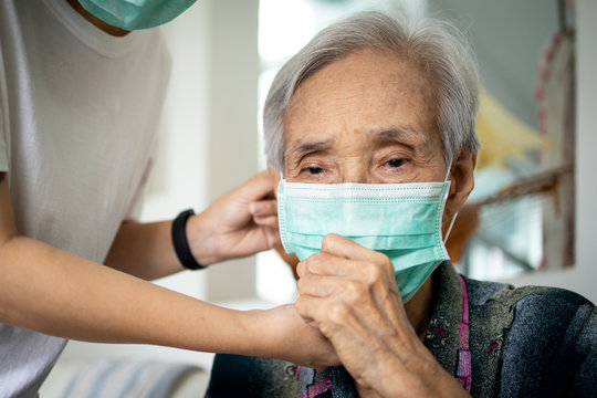 Elderly people have illness,fever and cough,infectious symptoms of flu,cold,pandemic of Covid-19,female caregiver wearing protective mask to sick senior woman,prevent outbreak,spread of Coronavirus