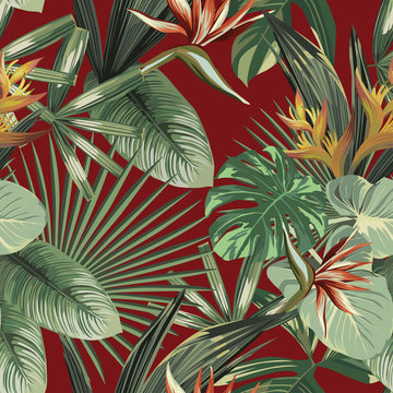 Exotic flowers tropical green leaves seamless red background