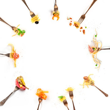 Italian food collage. Pasta design elements. Many forks with pasta and various addings, shot from above on a white background with copy space