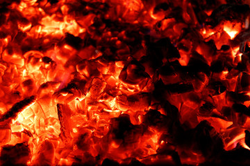 Very hot smouldering embers in the grill. Fire background for barbecue.
